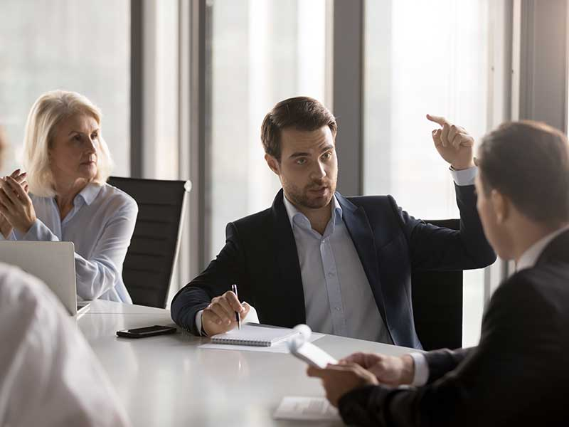 Business people in a serious meeting around a table